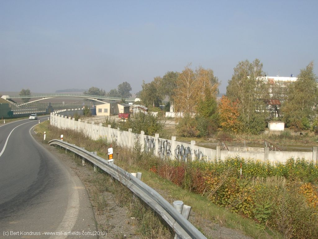 At the western end, near the motorway