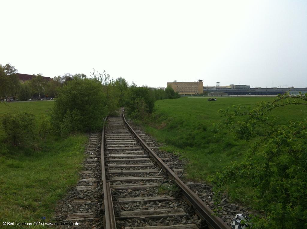 The railway siding goes further north to the airport building