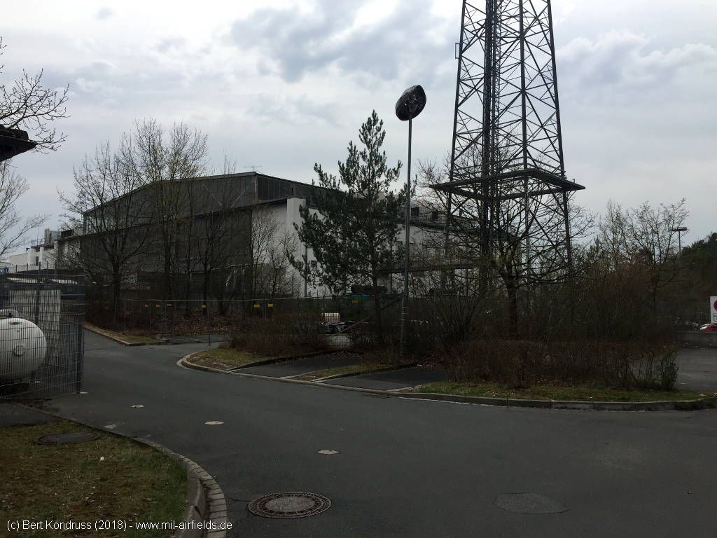 Telecommunications tower and hangar.
