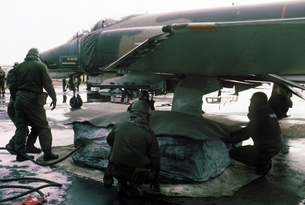 50th Civil Engineering Squadron repair a tire of an F-4E Phantom II at Hahn Air Base