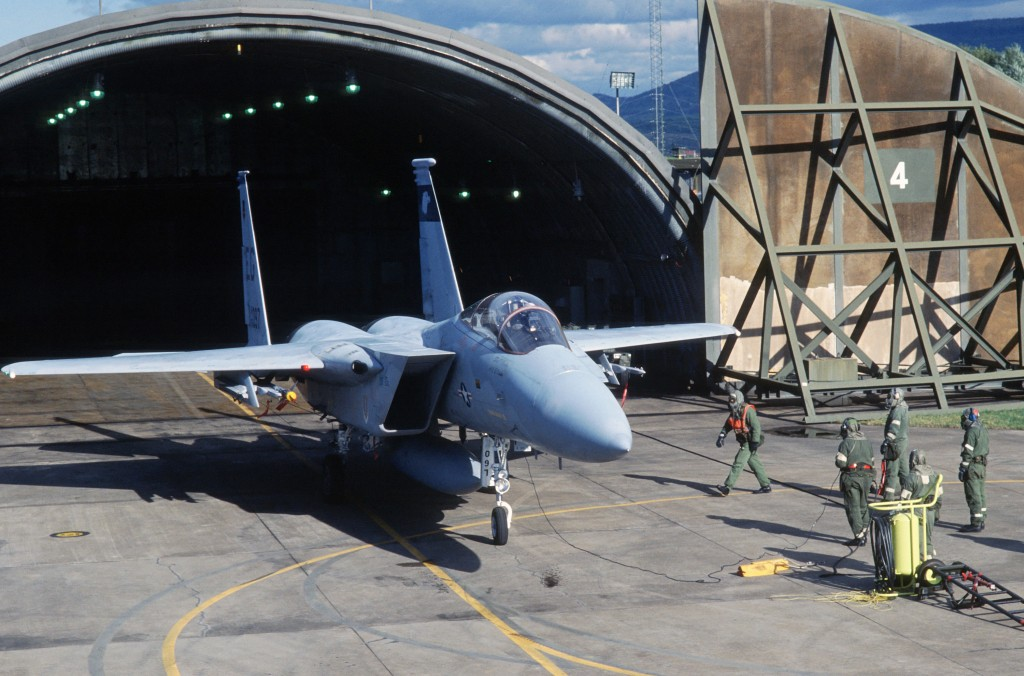 Aircraft F-15 pulled into hangar for integrated combat turnaround